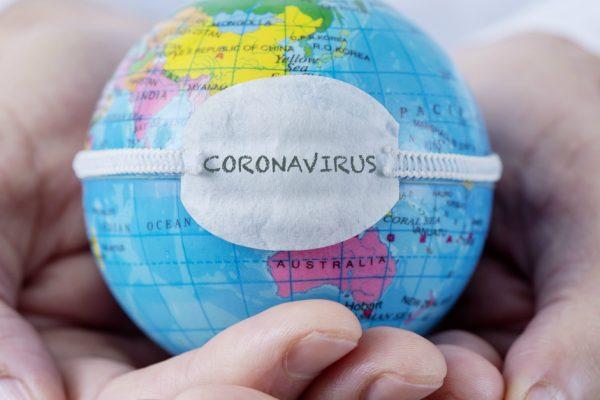 9136 Man Hands Holding Small Globe Witih Coronavir